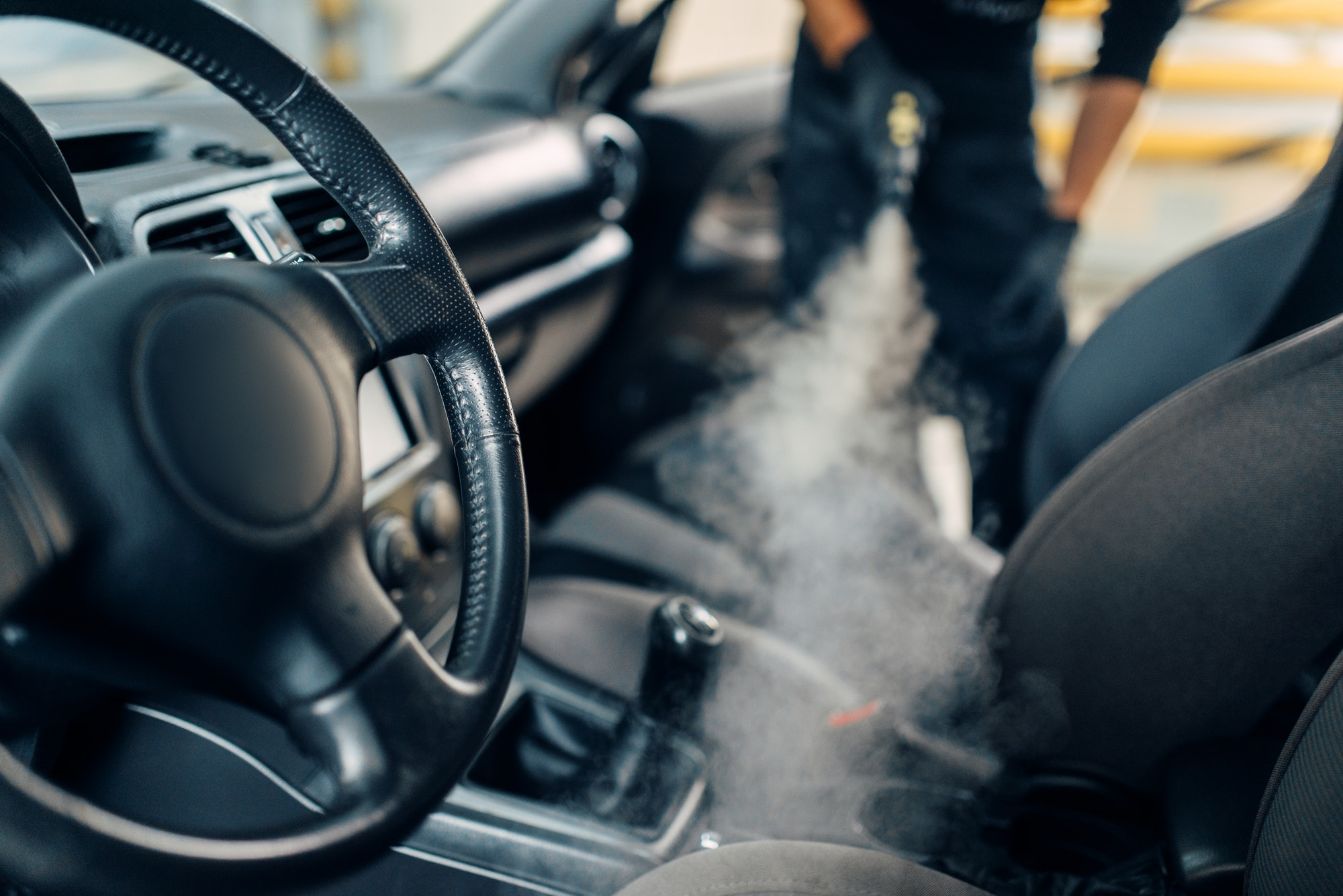 Cleaning of car salon with steam cleaner