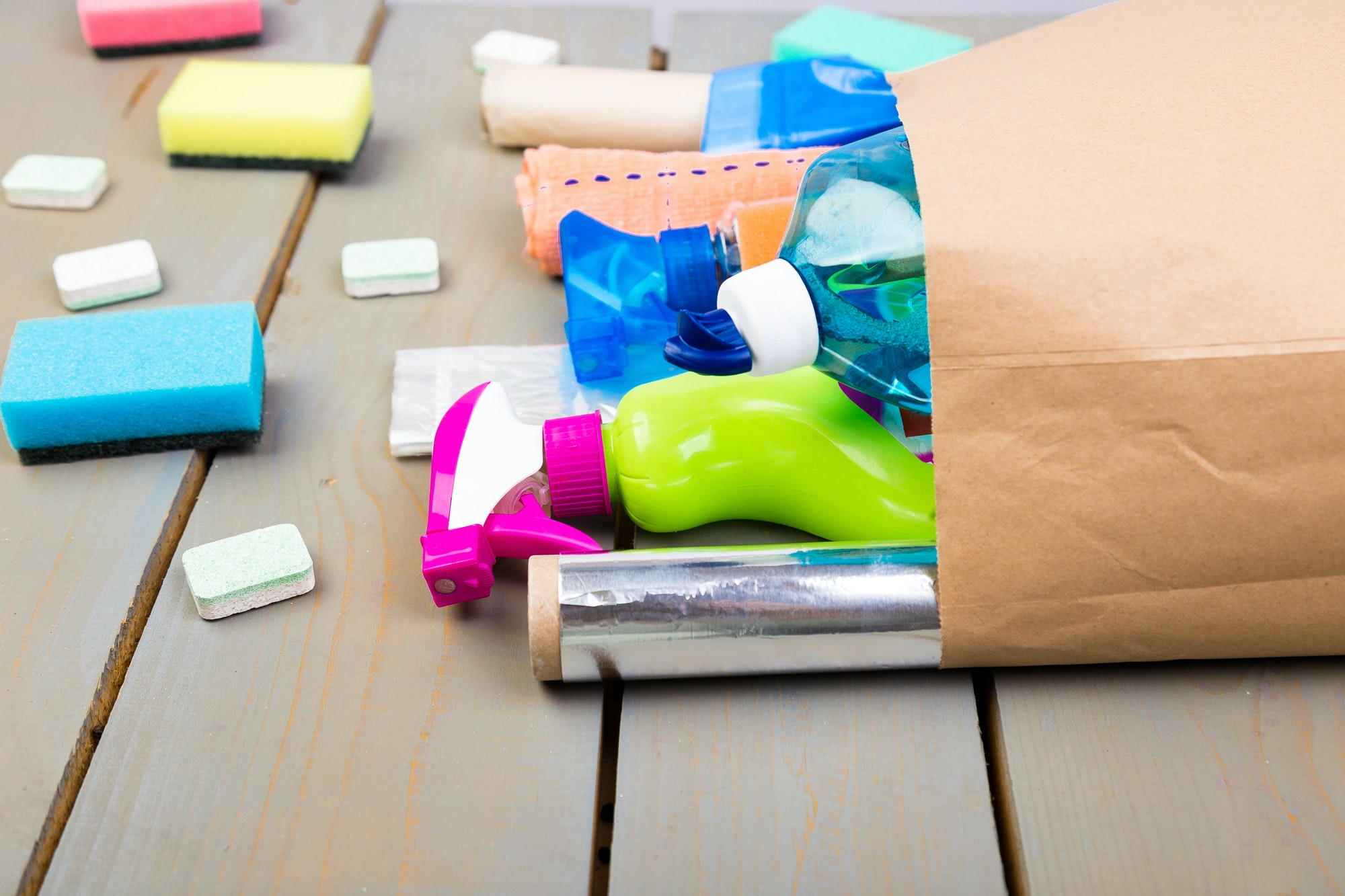 Full paper bag of different house cleaning product